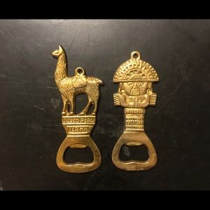 Set of two brass Peruvian bottle openers.